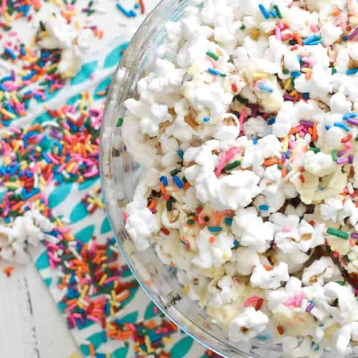 Overhead shot of colorful white chocolate popcorn covered in sprinkles