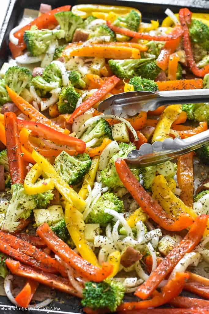A sheet pan full of colorful seasoned vegetables