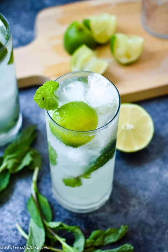A freshly made mojito with bright green mint and limes