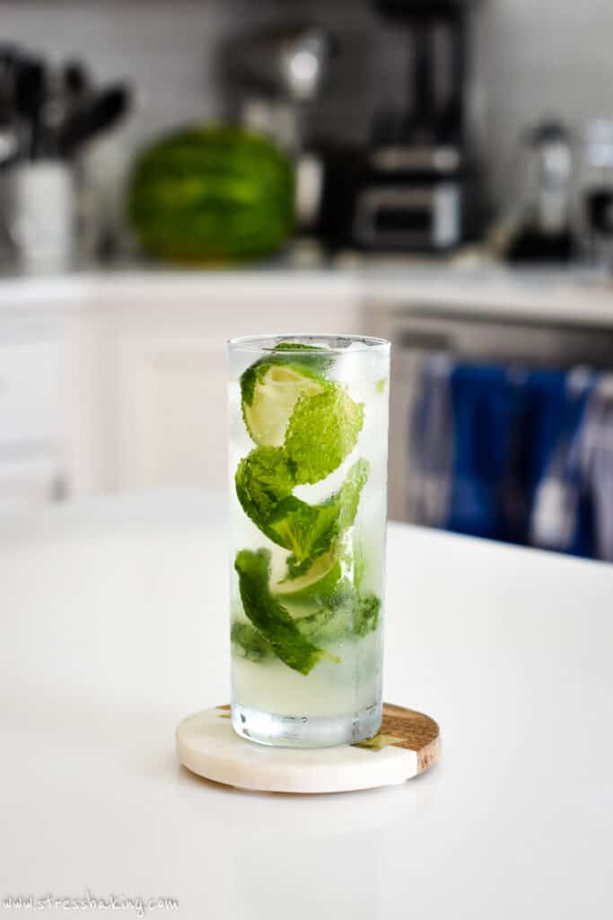 A light and bright glass of mojito on a kitchen counter