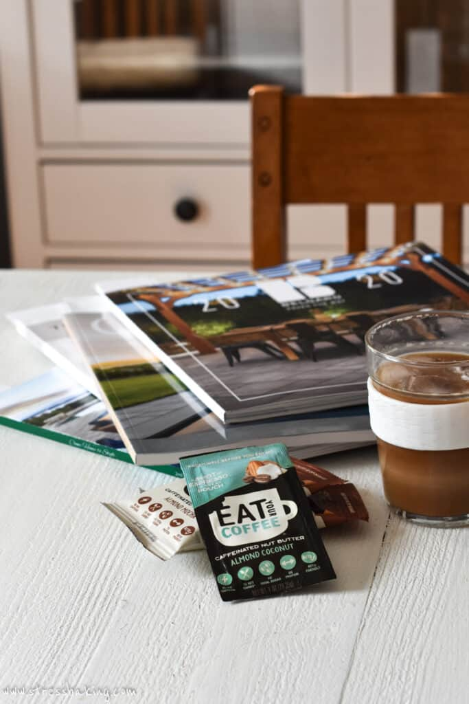 Eat Your Coffee Keto products next to a pile of magazines