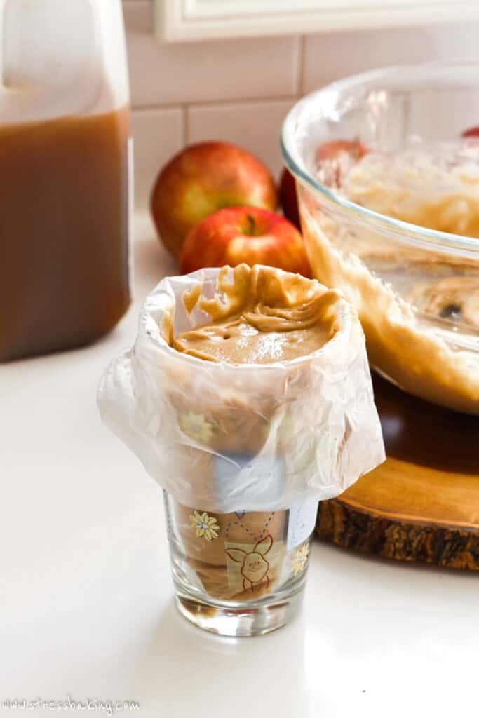 Apple cider donut batter in a pastry bag