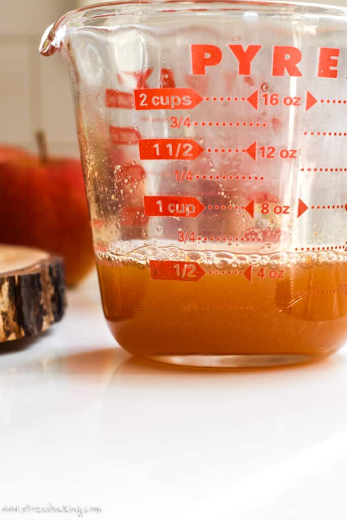 Reduced apple cider in a measuring cup
