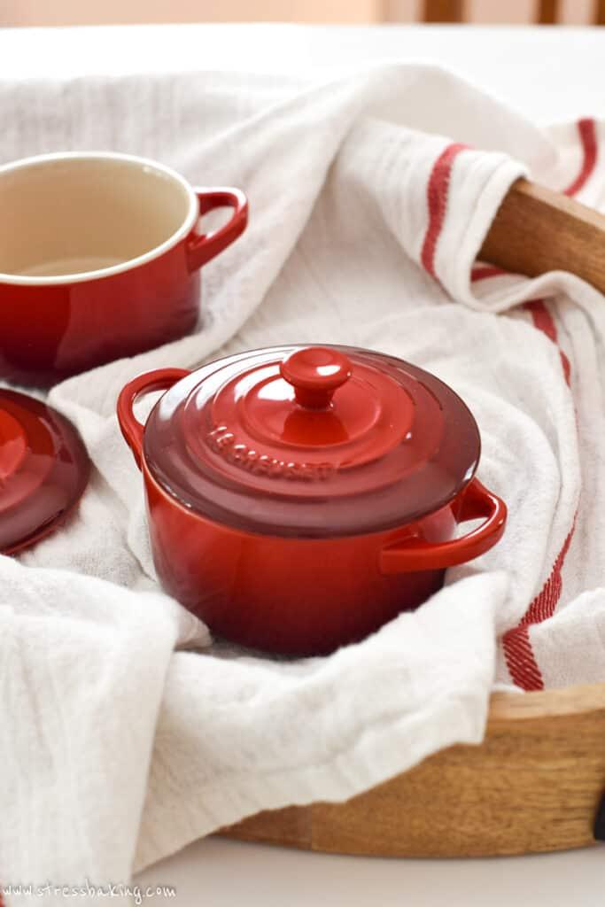 A red Le Creuset mini cocotte