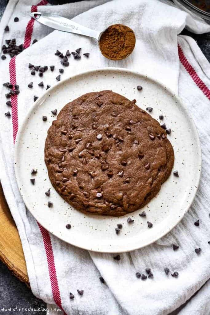 A giant double chocolate chip cookie on a plate