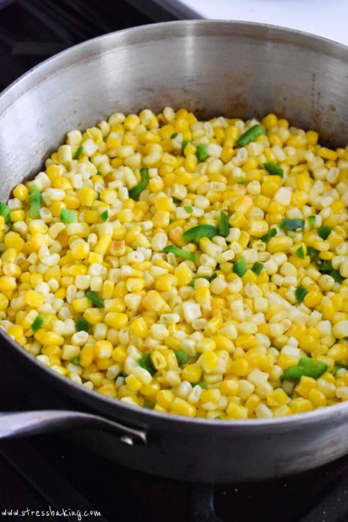 Corn and jalapenos in a saucepan