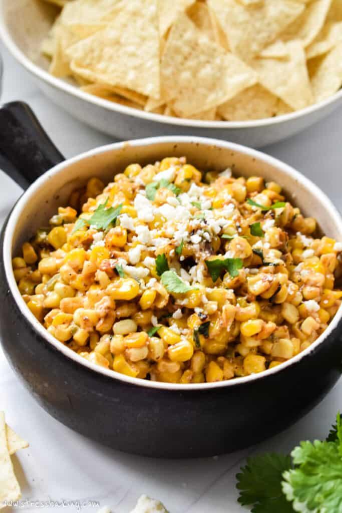 A crock of Mexican corn dip