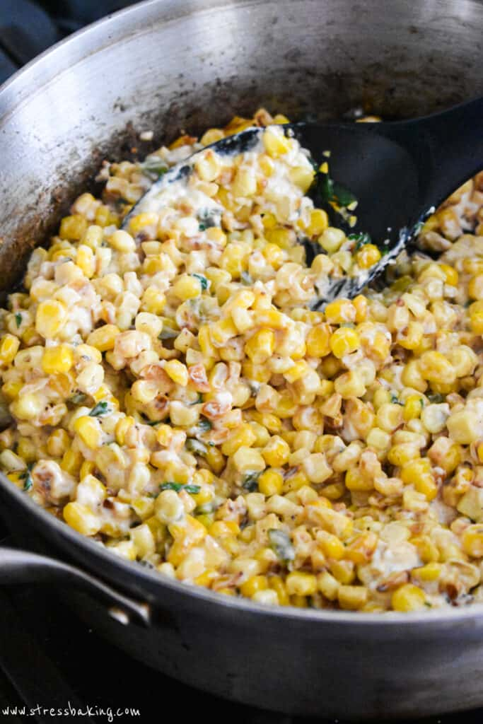 Mexican corn dip being cooked in a pan