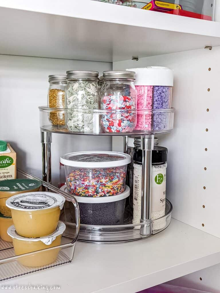 Jars of sprinkles on a two tier lazy susan