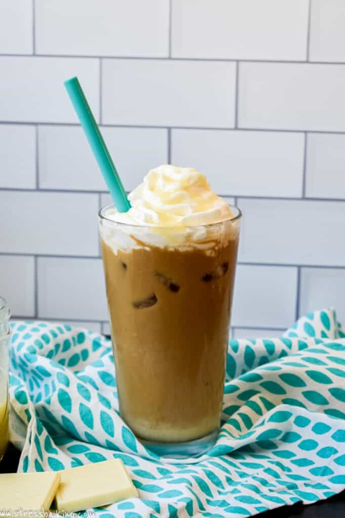 A copycat Starbucks iced white chocolate mocha with a teal straw