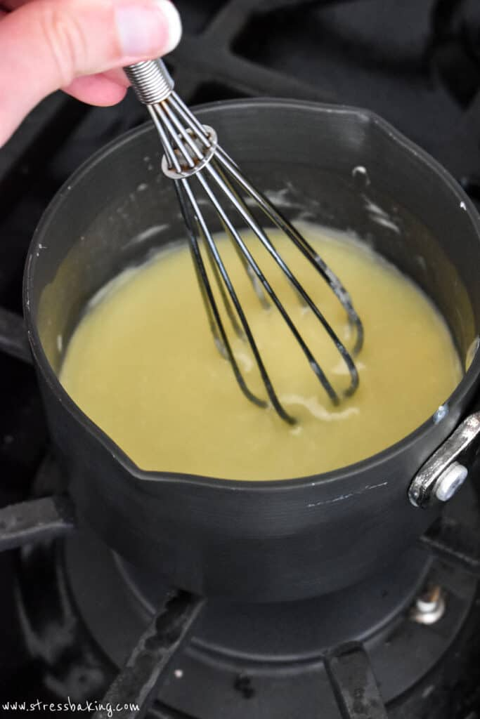 White chocolate sauce in a small saucepan
