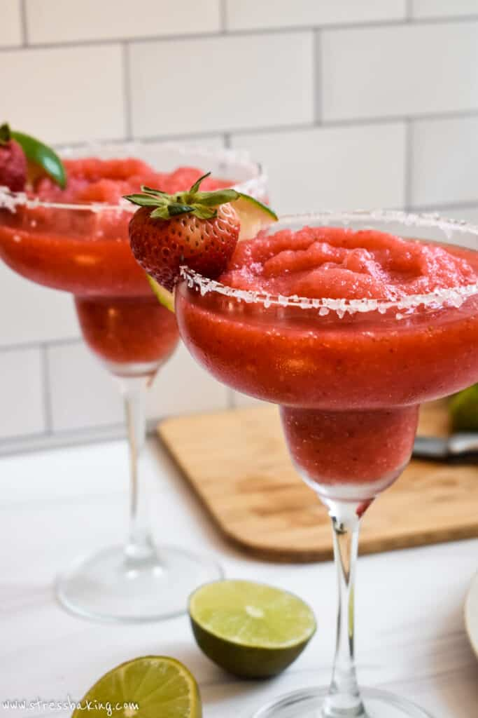 Close up of bright red blended frozen strawberry margaritas
