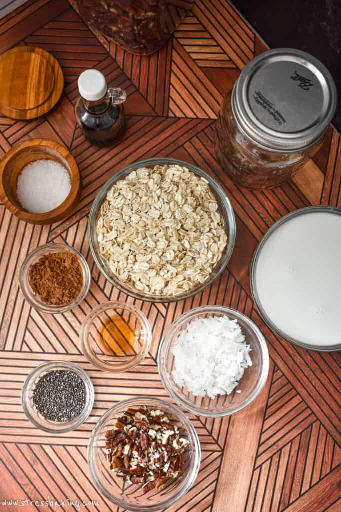 Bowls of ingredients for German Chocolate Cake overnight oats on a retro wooden surface