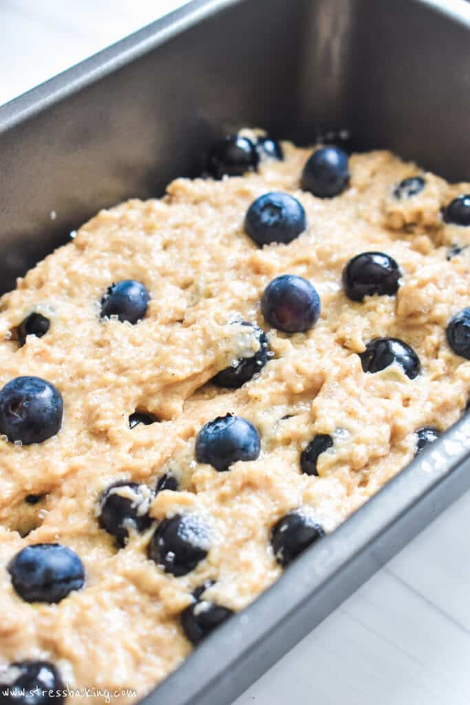 Blueberry muffin bread batter in a grey loaf pan