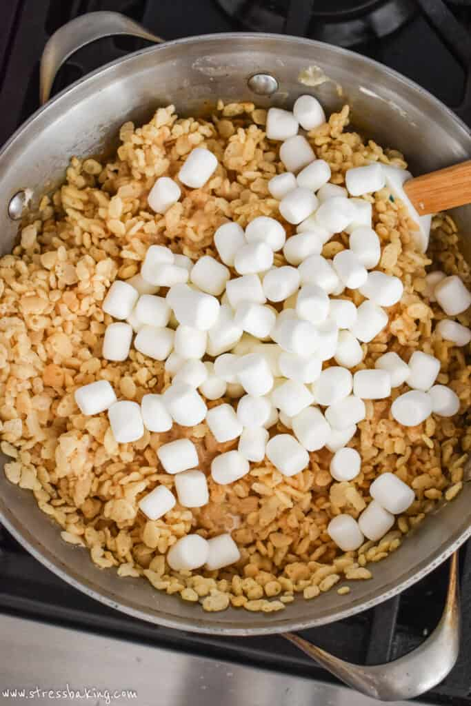 A pot of rice krispies and mini marshmallows about to be heated and mixed