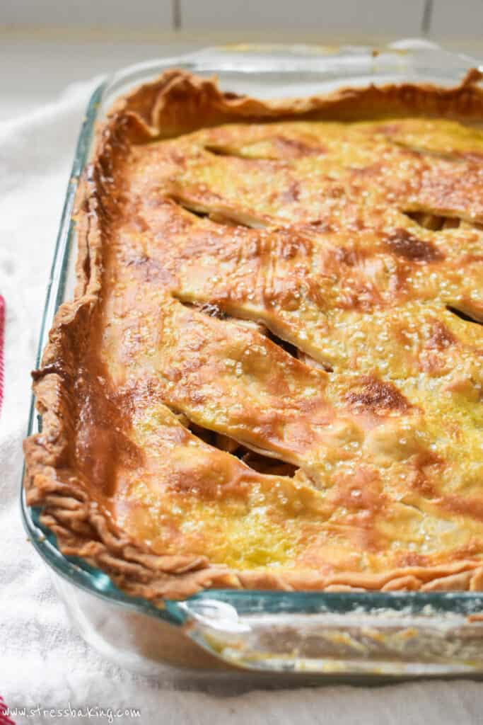 Close up of a golden brown apple pie crust
