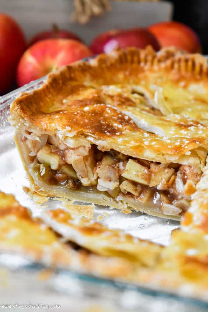 Closeup of the inside of apple pie showing the spiced diced apples and sliced almonds