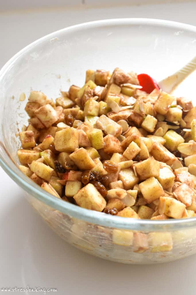 A clear bowl full of spiced diced apples