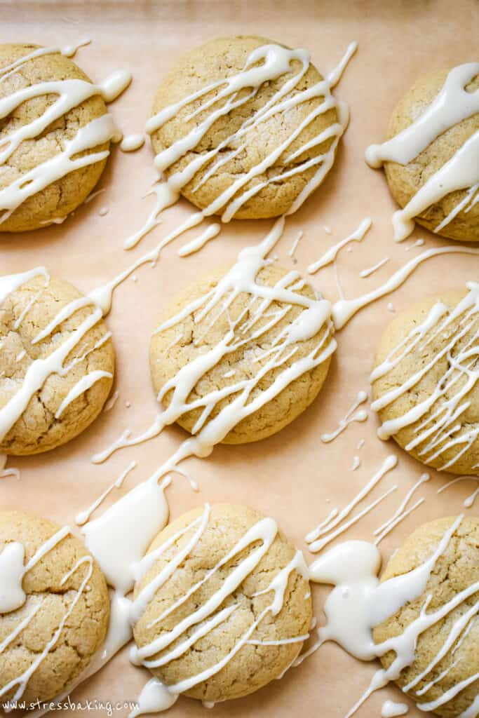 Nine maple sugar cookies with maple icing drizzled over the tops